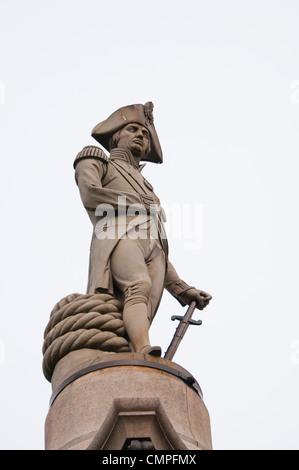 Nelsons column, Trafalgar Square in London - Stock Photo