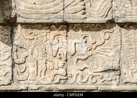 CHICHEN ITZA, Mexico - Winged warrior carving in a stone wall at Chichen Itza Mayan ruins, Mexico. - Stock Photo