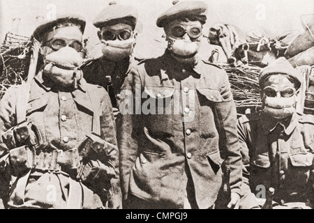Soldiers in Ypres during World War One using early gas masks, which were pads of cotton wool soaked in common washing - Stock Photo