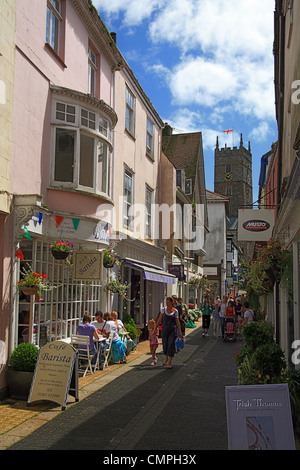 Shops for the tourists and holiday makers line Noss Street in Dartmouth, Devon, England, UK - Stock Photo