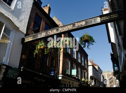 A sign for Ye Olde Starre Inne pub in York, UK - Stock Photo