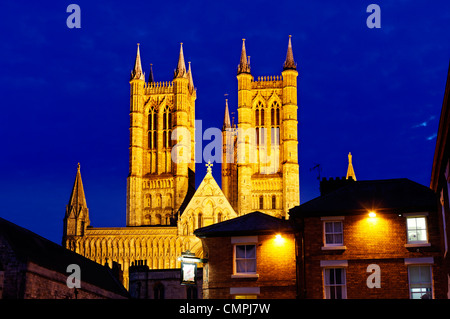 The cathedral and Cathedral Square in Lincoln UK at night - Stock Photo