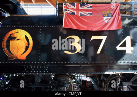 Red Ensign flag on the side of restored CPR Engine 374 at the Roundhouse in Yaletown, Vancouver, British Columbia, - Stock Photo