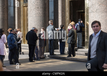 Buenos Aires people waiting in line at the Department of the Economy and Public Finance. - Stock Photo