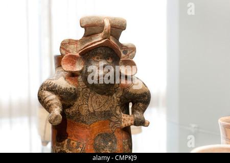 Mayan ceramic vase of a hunchback dwarf. Chilean Museum for Pre-Columbian Art, Museo Chileno de Arte Precolombino - Stock Photo