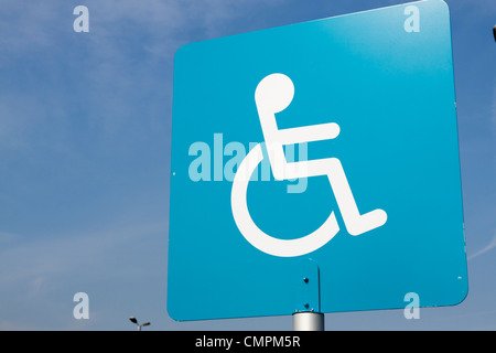 Disabled parking sign against blue sky, England, UK - Stock Photo