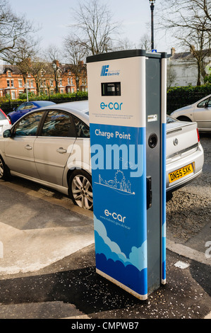 Electric car charging station on a street in Belfast - Stock Photo