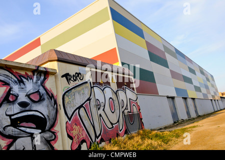 A Colorful piece of Graffiti in the Costa Brava photographed late in the evening - Stock Photo