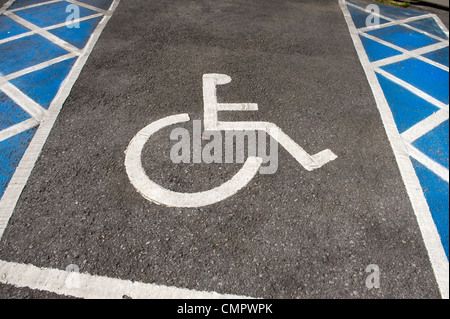 a disabled parking bay with wheelchair sign and parking distance chevrons - Stock Photo