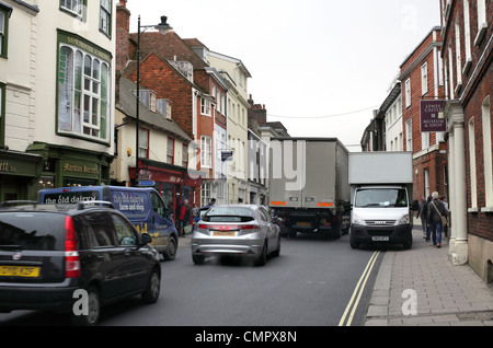 A van drives along the pavement in the congested town centre of Lewes, East Sussex - Stock Photo