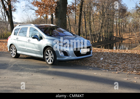 Peugeot 308 SW - MY 2007 (FL 2011) - French popular lower-medium class car (segment C) - at park - Stock Photo