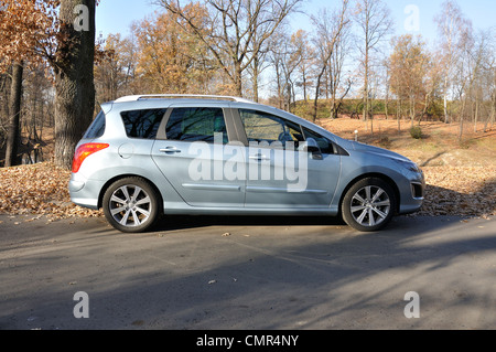 Peugeot 308 SW - MY 2007 (FL 2011) - Popular French  lower-medium class car (segment C) - at park - Stock Photo