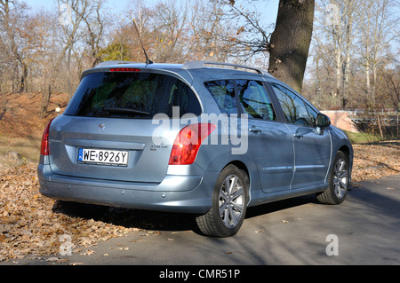 Peugeot 308 SW - MY 2007 (FL 2011) - Popular French  lower-medium class car (segment C) - at park - Stock Photo