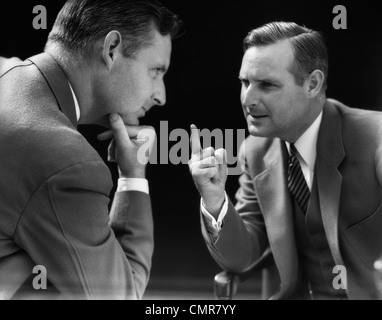 1930s SPECIAL EFFECT OF MAN TALKING AND ARGUING WITH HIMSELF - Stock Photo