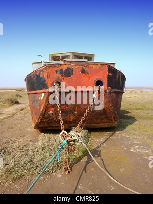 A converted barge made into a houseboat sitting high and dry on a saltmarsh 'East Anglia' UK - Stock Photo