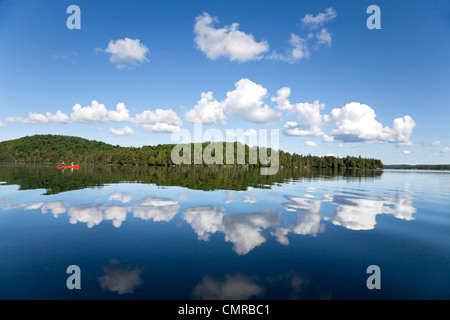 Senior couple canoeing on Smoke Lake, Algonquin Park, Ontario - Stock Photo