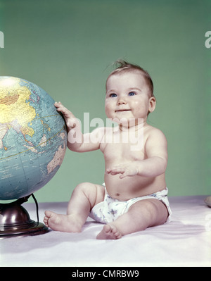 1960s Smiling Baby Sitting In Bathtub Bubble Bath Covered