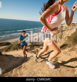 USA, California, San Diego, Two women jogging along sea coast - Stock Photo