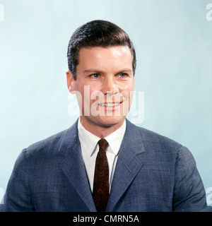 1960 1960s RETRO PORTRAIT SMILING MAN WEARING BLUE GREY SUIT AND TIE - Stock Photo