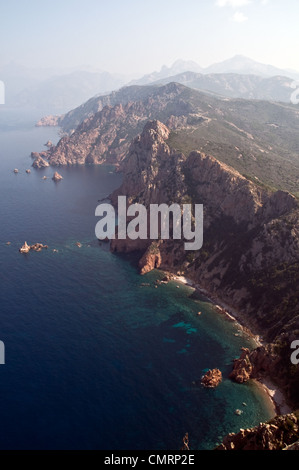 The view of the cliffs Capo Rosso and the Gulf of Porto in the Mediterranean, near Porto, on the west coast of the - Stock Photo