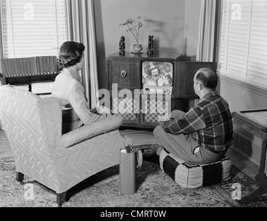 Living Room 1950s 1950s couple husband and wife watching tv in living room smiling