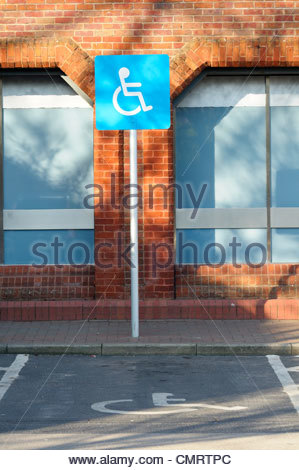 Disabled parking bay sign,Poole, Dorset England - Stock Photo