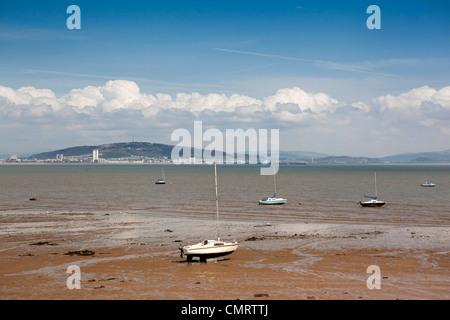 UK, Wales, Swansea, Mumbles, pleasure craft moored in Swansea Bay at low tide - Stock Photo