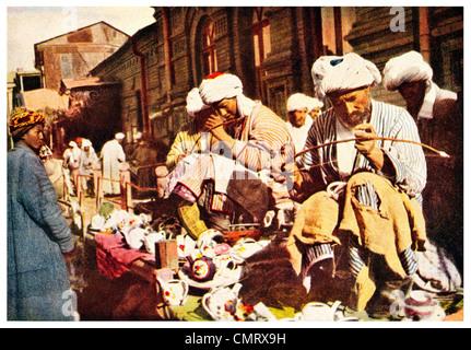 1919 Samarkand Men repair  broken crockery Uzbekistan - Stock Photo