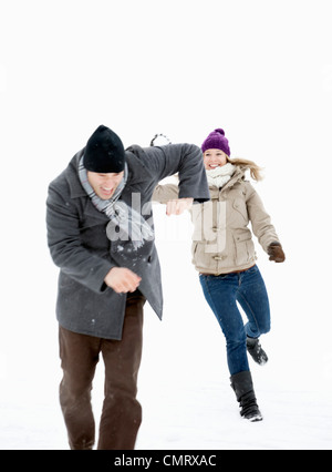 Two throwing snowballs - Stock Photo