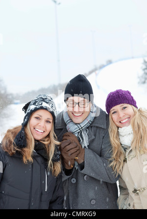 Three friends in winter clothes - Stock Photo