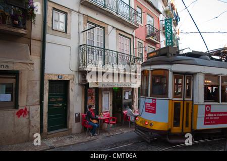 Tram 28 going through Alfama district Lisbon Portugal Europe - Stock Photo