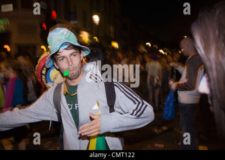 A reveler at the Notting Hill Carnival, London - Stock Photo