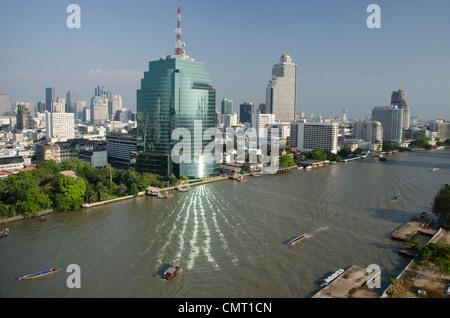 Thailand, Bangkok. Downtown Bangkok skyline view with Chao Phraya river. Building window reflection on river. - Stock Photo