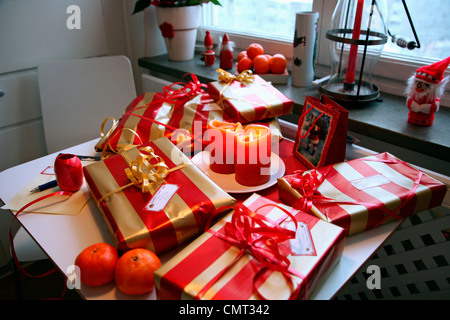 High angle view of Christmas gifts placed on table