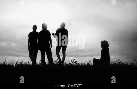 Young people talking and having fun at sunset - Stock Photo