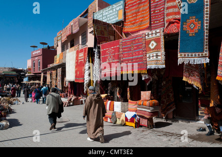 Marrakech, Morocco - Street scene in the busy souk market at Rahba Qedima in Medina district, Marrakech, North Africa - Stock Photo