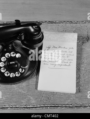 1930s 1940s ROTARY TELEPHONE NOTE PAD WITH PHONE MESSAGE - Stock Photo