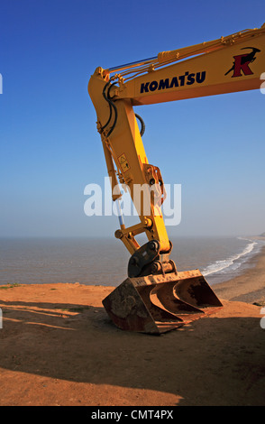 A close-up of the arm and bucket of an excavator positioned on the cliff top at Happisburgh, Norfolk, England, United - Stock Photo