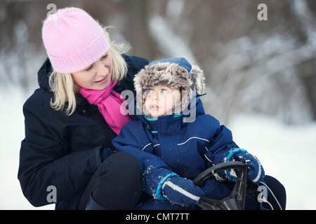 Mother and her son (4-5) having fun in winter - Stock Photo