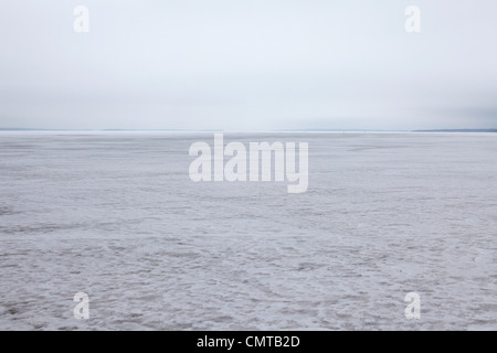 The frozen expanse of ice over Lake Näsijärvi at Tampere, Finland. - Stock Photo