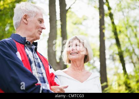 Senior men and women having a conversation - Stock Photo