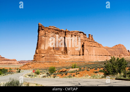 Desert road winds through Arches National Park near Moab Utah - Stock Photo