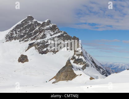 top of 4,158 m high mountain Jungfrau, Bernese alps Switzerland with mountain station Sphinx, seen from Jungfraujoch - Stock Photo