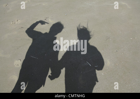 Shadow of couple on sand at beach - Stock Photo