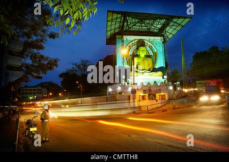 Sri Lanka, Kandy - Buddha statue in the city center, city by night, Sri Lanka, Asia - Stock Photo