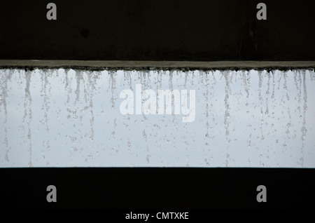 Curtain of water seen from inside a building - Stock Photo