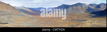 Hikers standing above North Klondike Valley, Yukon - Stock Photo