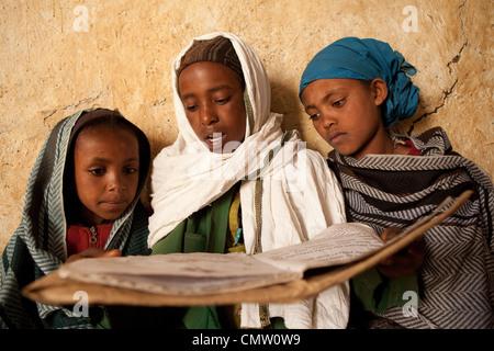 Children read together in Ankober, Ethiopia. - Stock Photo