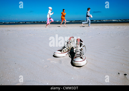 Shoes with children playing in background - Stock Photo