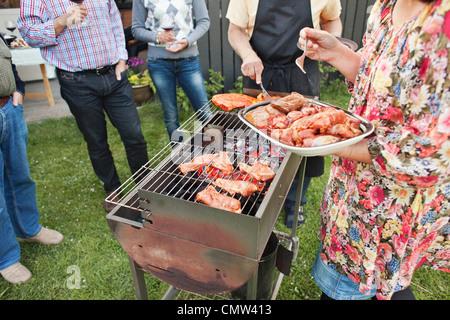 Backyard barbecue party - Stock Photo